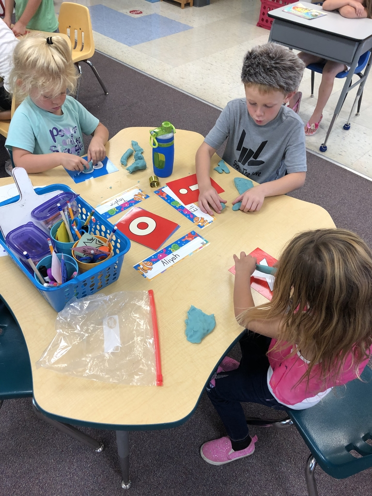 Building letters with play-doh