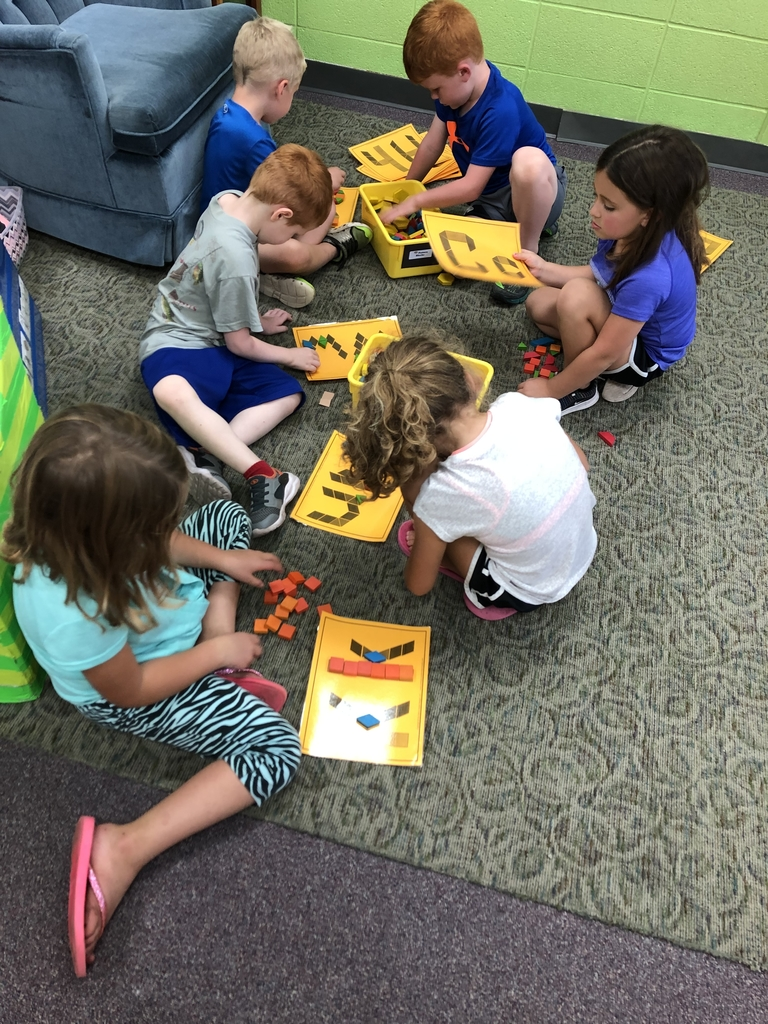 Using pattern blocks to build letters